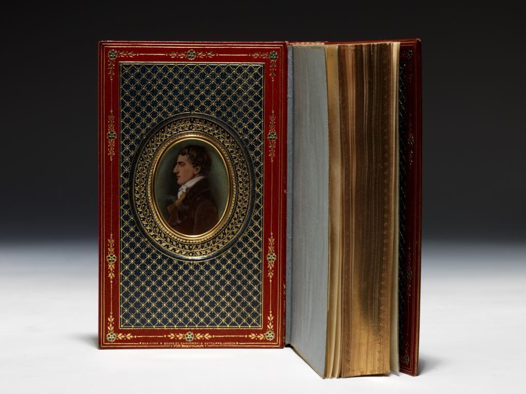 The first collection in book form of Charles Lamb's Elia essays, beautifully bound by Sangorski & Sutcliffe in an exquisite full red morocco Cosway-style binding, inset on the front doublure with a wonderful watercolor portrait of Lamb (BRB 80867)