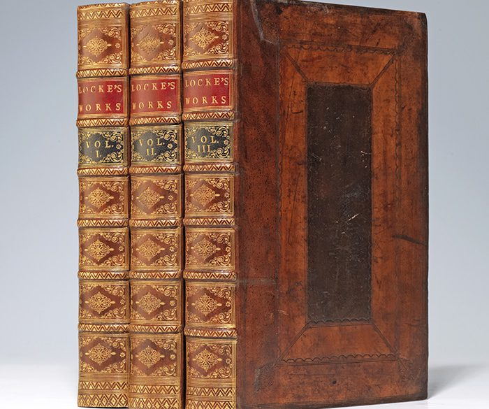 A rebacked copy of Locke's Works with bright gilt